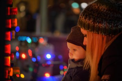 Mom and child looking at lights